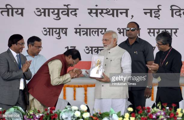Prime Minister Narendra Modi and Minister of State for AYUSH Shripad Yesso Naik and other dignitaries during an event to dedicate first ever All...