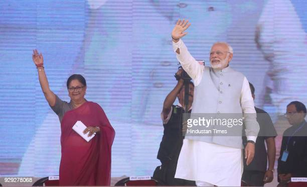 Prime Minister Narendra Modi and Rajasthan Chief Minister Vasundhara Raje at a public rally at the launch of National Nutrition Mission on March 8...