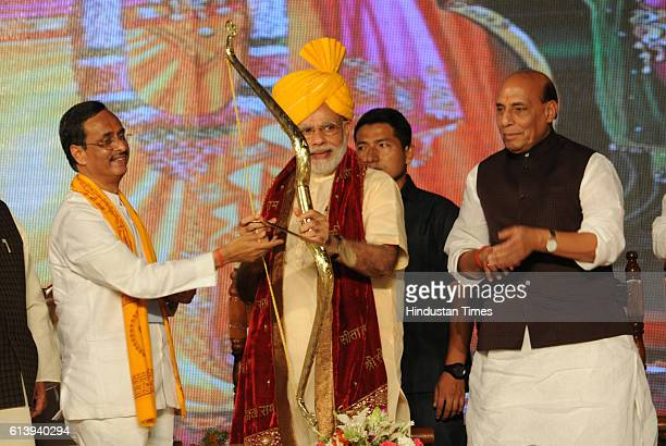 Prime Minister Narendra Modi and Union Home Minister Rajnath Singh with others during an occasion of Dussehra celebrations at Ramleela Ground...