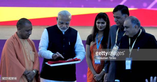 Prime Minister Narendra Modi and Uttar Pradesh Chief Minister Yogi Adityanath at the inaugural session of the UP Investors' Summit 2018 at the Indira...