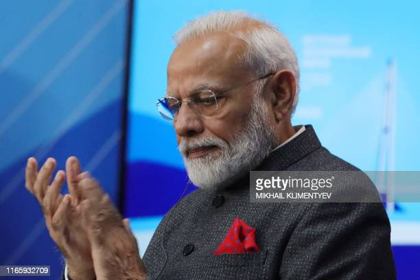 Prime Minister Narendra Modi applauds to Russian President during their talks as part of the Eastern Economic Forum in Vladivostok on September 4,...