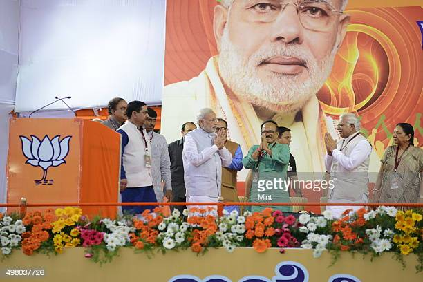 Prime Minister Narendra Modi arrives to address a public meeting at National College Ground in Basavanagudi on 3rd evening after spending day in...