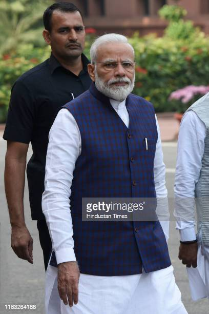 Prime Minister Narendra Modi arrives to address the media during the first day of winter session of Parliament in the presence of Union Ministers on...