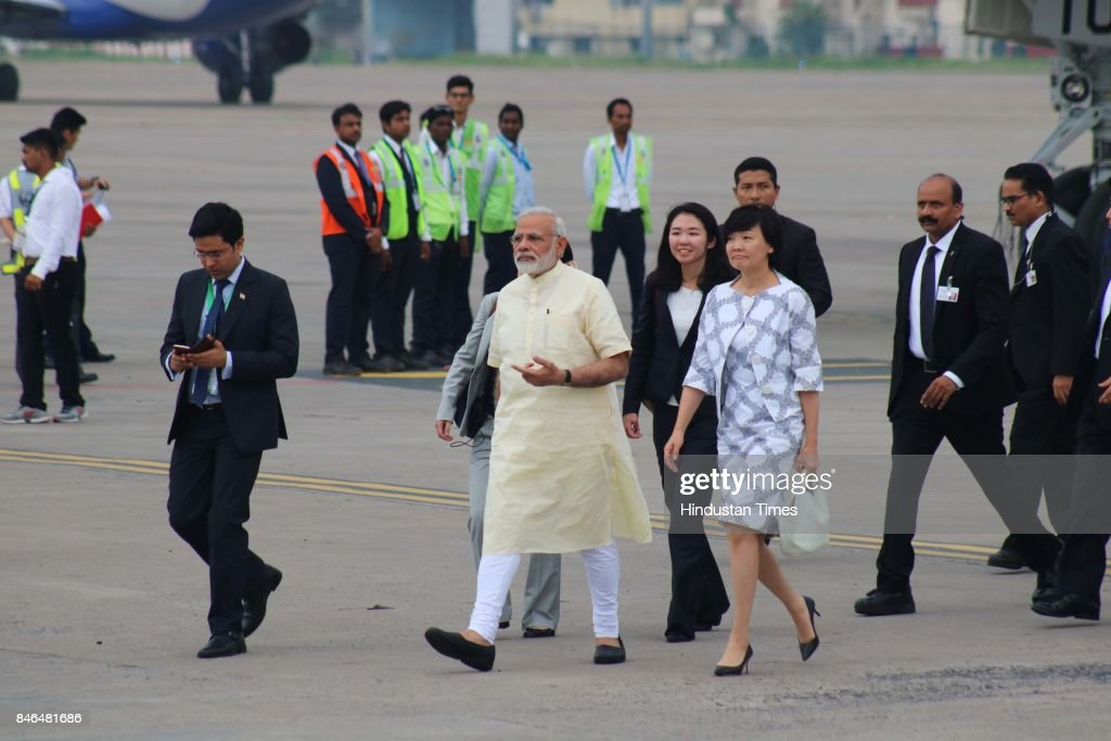 Prime Minister Narendra Modi arrives to welcome Japanese Prime Minister Shinzo Abe at airport, on September 13, 2017 in Ahmadabad, India. Japanese Prime Minister Shinzo Abe arrived in Ahmedabad on Wednesday at the start of a two-day visit to host Prime Minister Narendra Modi's home state of Gujarat, with the two leaders aiming to further shore up economic and strategic ties between their nations.