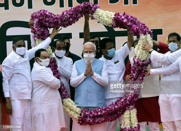 Prime Minister Narendra Modi being felicitated upon his arrival from the US, at Palam technical Airport, on September 26, 2021 in New Delhi, India....