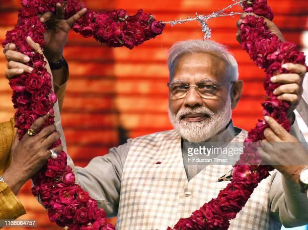 Prime Minister Narendra Modi being garlanded at ''Traders Sammelan' at Talkatora Stadium on April 19 2019 in New Delhi India Modi said the BJPled NDA...