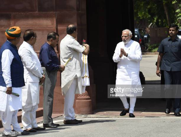 Prime Minister Narendra Modi being greeted by Parliamentary Affairs Minister Ananth Kumar Union MoS for Parliamentary Affairs Vijay Goel MoS Arjun...