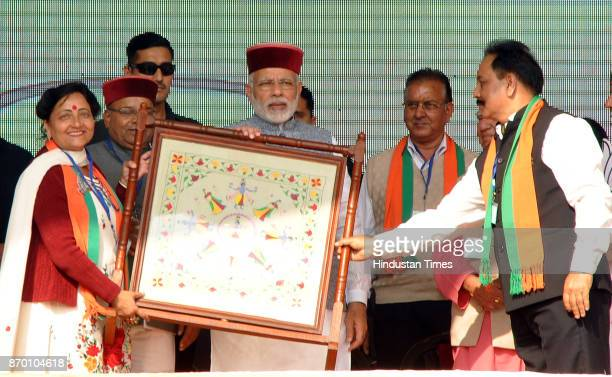 Prime Minister Narendra Modi being presented a momento by state party leaders during a BJP Parivartan Rally at Rait on November 4 2017 in Dharamsala...