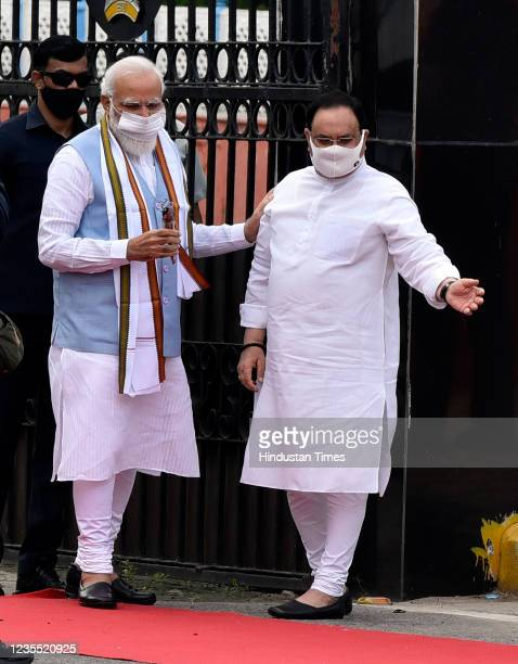 Prime Minister Narendra Modi being received by BJP President JP Nadda upon his arrival from the US, at Palam technical Airport, on September 26, 2021...