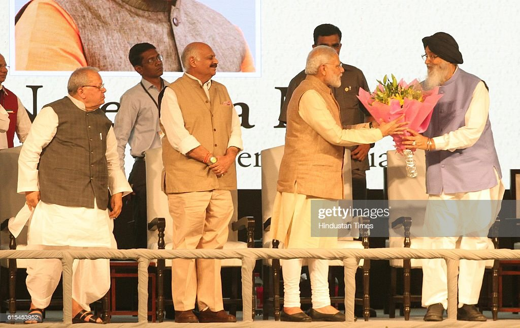 Prime Minister Narendra Modi being welcomed by Punjab CM Parkash Singh Badal during a function at PAU on October 18 2016 in Ludhiana India
