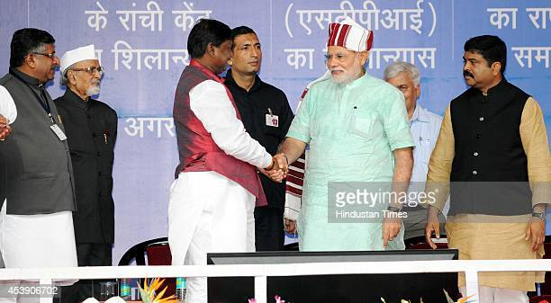 Prime Minister Narendra Modi being welcomed with traditional tribal turban by former state Chief Minister Arjun Munda in the presence of Jharkhand...
