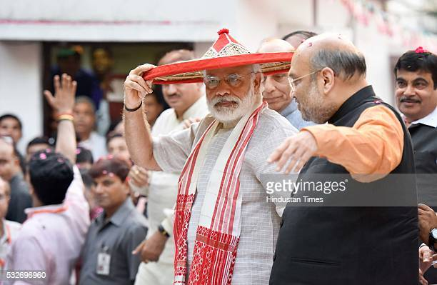 Prime Minister Narendra Modi BJP National President Amit Shah Union Home Minister Rajnath Singh with other BJP ministers and activists celebrate...