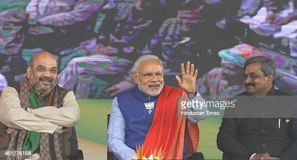Prime Minister Narendra Modi BJP President Amit Shah and BJP Delhi President Satish Upadhyay during the 'Abhinandan rally' at Ramlila Maidan on...