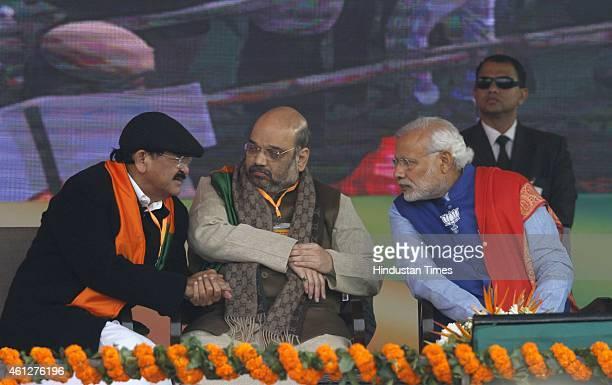 Prime Minister Narendra Modi BJP President Amit Shah and BJP Senior Leader Venkaiah Naidu during the 'Abhinandan rally' at Ramlila Maidan on January...