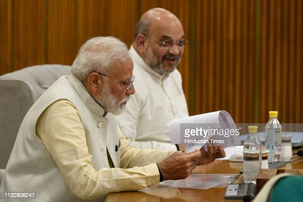 Prime Minister Narendra Modi BJP President Amit Shah and other party leaders attending a BJP Central Election Committee meeting at BJP headquarters...