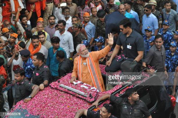 Prime Minister Narendra Modi during a road show at Bhadaini road on April 25, 2019 in Varanasi, India. PM Modi's cavalcade will pass through the main...