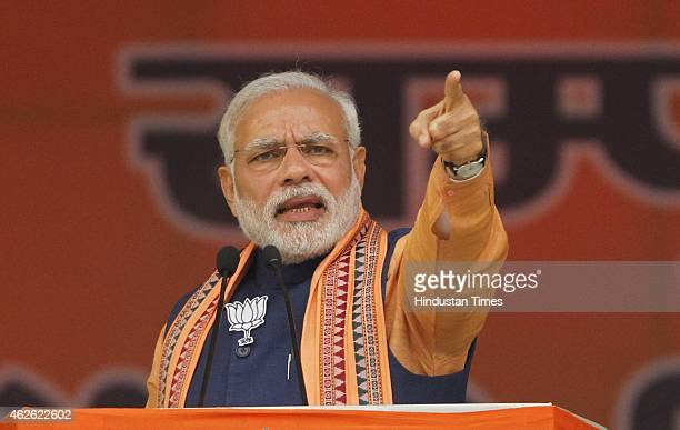 Prime Minister Narendra Modi during an election campaign rally at Dwarka on February 1 2015 in New Delhi India Modi said Don't do aadhaadhoora Delhi...