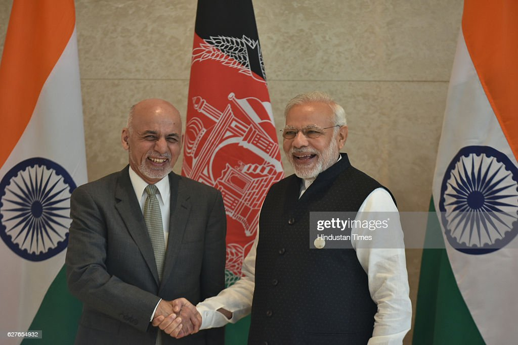 Prime Minister Narendra Modi exchange greeting with Afghanistan President Ashraf Ghani during the inaugural session of 6th ministerial Heart of Asia..