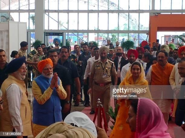 Prime Minister Narendra Modi flags off the first jatha headed for Gurudwara Darbar Sahib in Kartarpur from the passenger terminal on November 9 2019...