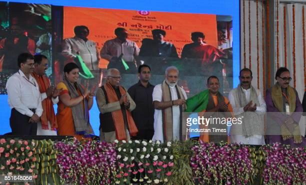 Prime Minister Narendra Modi flags off third Mahamana Express to run between Varanasi and Vadodara as UP CM Yogi Adityanath Union Minister Smriti...