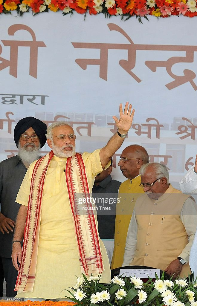 Prime Minister Narendra Modi flanked by Punjab CM Parkash Singh Badal Haryana CM Manohar Lal and Haryana Governor Kaptan Singh Solanki during a rally.