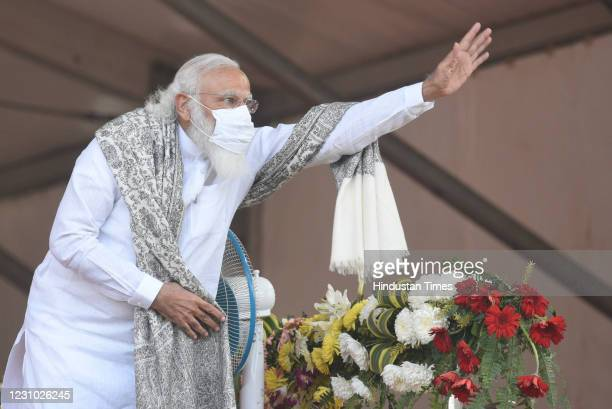 Prime Minister Narendra Modi gestures at the gathering during a public rally at Haldia, on February 7, 2021 in Kolkata, India. PM Modi questioned the...