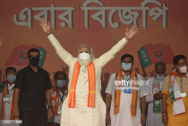 Prime Minister Narendra Modi gestures at the gathering during a public rally for West Bengal Assembly Election at Barasat on April 12, 2021 in North...