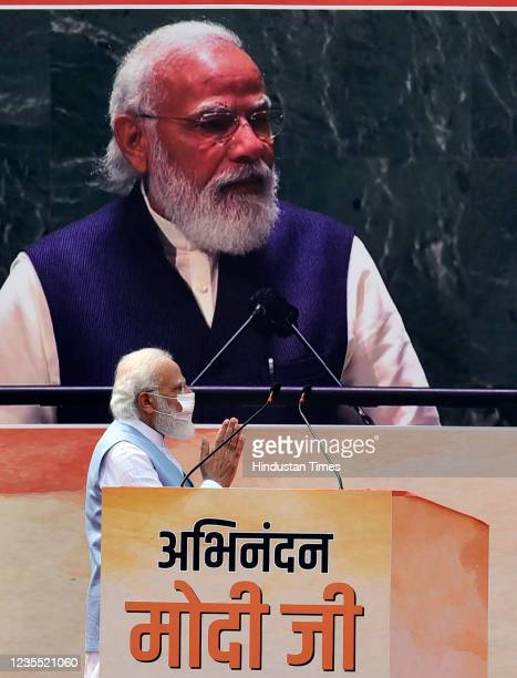 Prime Minister Narendra Modi gestures while addressing the gathering upon his arrival from the US, at Palam technical Airport, on September 26, 2021...
