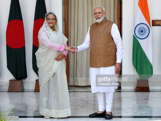 Prime Minister Narendra Modi greets Bangladesh Prime Minister Sheikh Hasina before their bilateral talk at Hyderabad House on October 5 2019 in New...