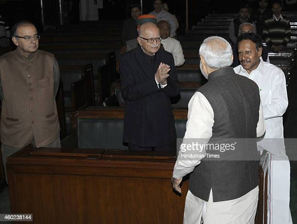 Prime Minister Narendra Modi greets Lok Sabha Deputy Speaker M Thambi Durai BJP leader Lal Krishan Advani and Minister of Finance Arun Jaitley during...