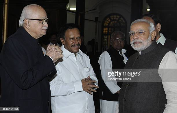 Prime Minister Narendra Modi greets Lok Sabha Deputy Speaker M Thambi Durai and BJP leader Lal Krishan Advani during a function to pay tribute to...