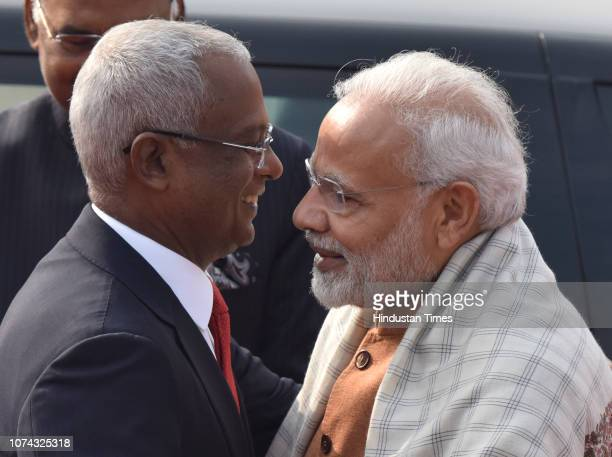 Prime Minister Narendra Modi greets Maldivian President Ibrahim Mohamed Solih during Solih's ceremonial reception at Rashtrapati Bhawan on December...
