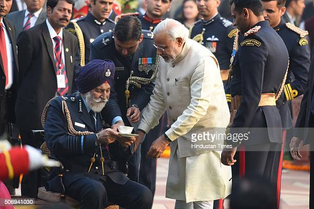 Prime Minister Narendra Modi greets Marshal of the Indian Air Force Arjan Singh during At Home reception at President's House on January 26 2016 in...