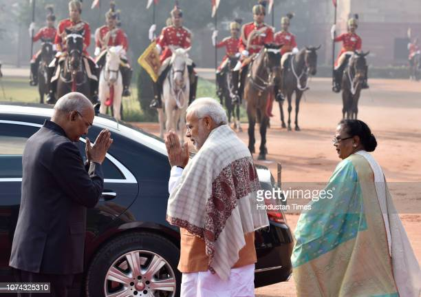 Prime Minister Narendra Modi greets President Ram Nath Kovind as his wife Savita Kovind looks on during Maldivan President Ibrahim Mohamed Solih's...