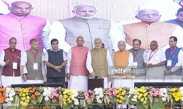 Prime Minister Narendra Modi Haryana Chief Minister Manohar Lal Khattar Minister of Road Transport and Highways Nitin Gadkari Haryana Governor Kaptan...