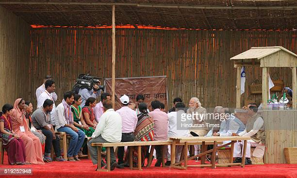 Prime Minister Narendra Modi having chai pe charcha with erickshaw beneficiaries before launching the government's 'Stand Up India' initiative on the...