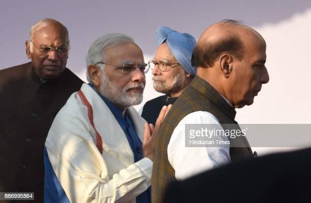 Prime Minister Narendra Modi Home minister Rajnath singh former prime minister Manmohan singh and congress leader Mallikarjun Kharge paying floral...