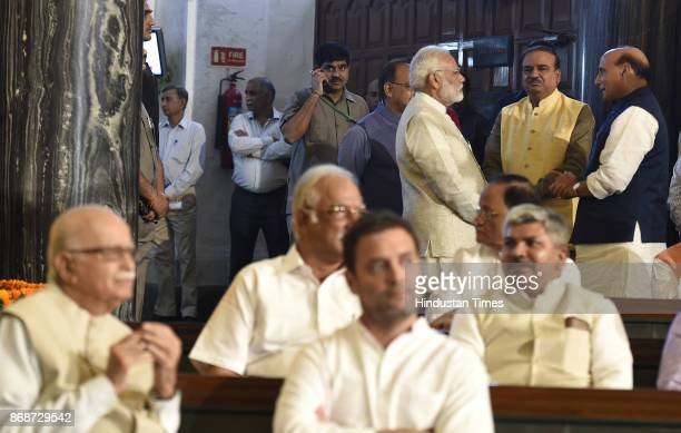 Prime Minister Narendra Modi Home minister Rajnath Singh LK Advani with Congress Vice President Rahul Gandhi and other leaders during a floral...
