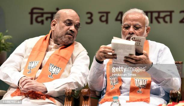 Prime Minister Narendra Modi in conversation with Union Home Minister Amit Shah during the two day training programme Abhyas Varga for all BJP...