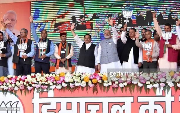 Prime Minister Narendra Modi introducing all BJP candidates of Mandi district during an election rally at Jwahar Park Sundernagar in Mandi district...