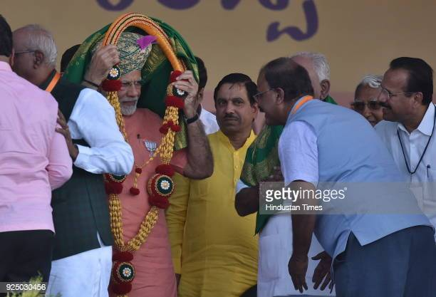 Prime Minister Narendra Modi is being felicitated by the BJP leaders during Farmer's Convention on February 27 2018 in Davangere India PM Modi's...