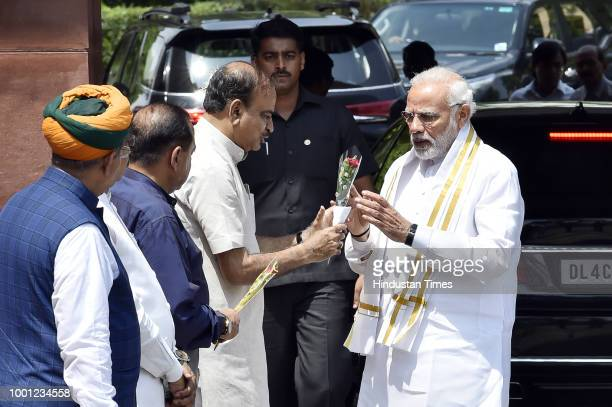 Prime Minister Narendra Modi is greeted by Parliamentary Affairs Minister Ananth Kumar Union Minister for Development of North Eastern Region...