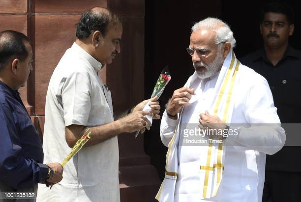 Prime Minister Narendra Modi is greeted by Parliamentary Affairs Minister Ananth Kumar as he arrives to address the media ahead of the Monsoon...