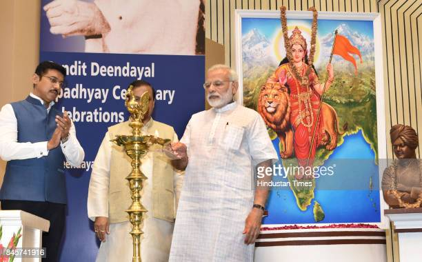 Prime Minister Narendra Modi lights the lamp on the 125th anniversary of Swami Vivekananda's Chicago address and Pandit Deen Dayal's anniversary at...
