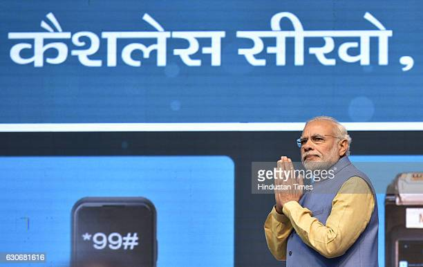 Prime Minister Narendra Modi looks on before launching a digital payment app linked with a nationwide biometric database during the Digi Dhan Mela on...