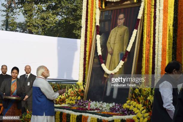 Prime Minister Narendra Modi paying tribute to Dr BR Ambedkar on his 61st mahaparinirvan diwas at Parliament house on December 6 2017 in New Delhi...