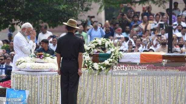 Prime Minister Narendra Modi pays his final respects during the cremation ceremony of former Prime Minister Atal Bihari Vajpayeeat Rashtriya Smriti...