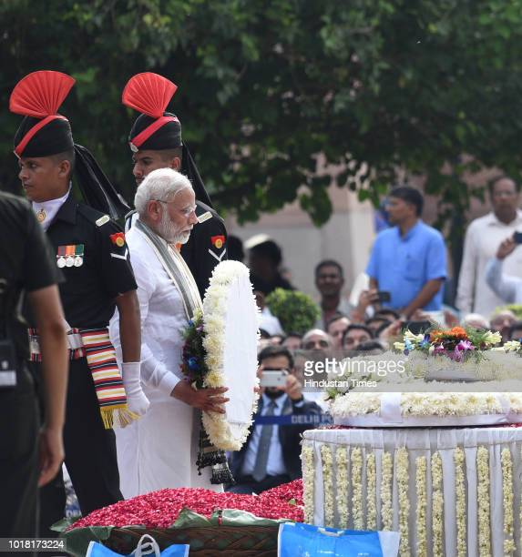 Prime Minister Narendra Modi pays his last respect during the cremation ceremony of former Prime Minister Atal Bihari Vajpayee at Rashtriya Smriti...