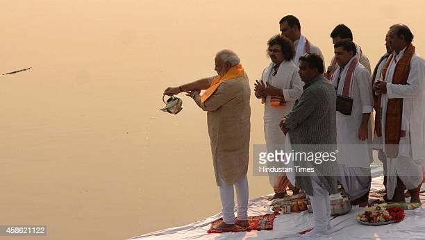 Prime Minister Narendra Modi performing Ganga aarti pooja after cleaning Assi ghat on November 8 2014 in Varanasi India Modi nominated nine persons...