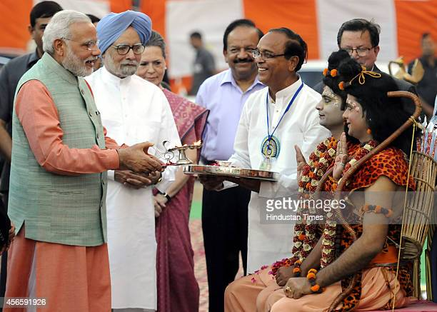 Prime Minister Narendra Modi performs Aarti of artists enacting Lord Ram and Laxman as Congress president Sonia Gandhi and former Prime Minister...